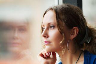 Bigstock-Beautiful-woman-looking-throug-20311445 (2)