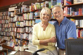 Bigstock-Couple-running-bookshop-13904324 (1)