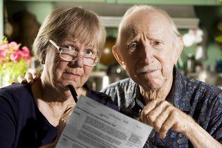 Bigstock-Elder-Couple-With-Bills-3557267 (2)